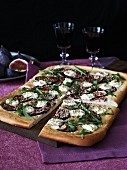 A fig and cream cheese pizza