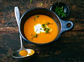 Exotic carrot soup with ginger and sour cream