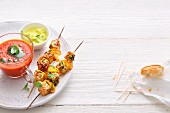 Finger food on skewers and in bowls