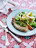 Pork chop with pesto and broccoli