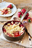 Strawberry and rhubarb crumble in a saucepan