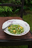 Gnocchi sardi pasta with broad beans, courgettes, basil pesto and flaked almonds