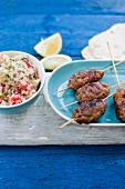 Lamb koftas with a lemon yoghurt sauce, unleavened bread and tabbouleh
