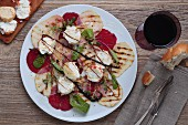 Beetroot carpaccio with grilled fruit, goat's cheese and maple syrup