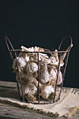 A garlic rope in a wire basket