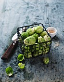 Brussels sprouts in a small wire basket