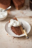 A slice of chocolate cheesecake with whipped cream