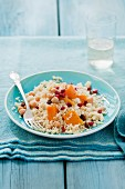 Couscous with butternut squash, chick peas, raisins, pomegranate seeds and cumin