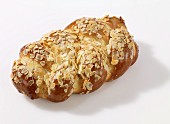A bread plait with slivered almonds