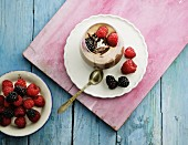 Banana and chocolate ice cream with berries