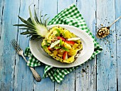 Exotic fruit salad served in a pineapple