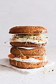 Sesame seed bagels with salmon, bean sprouts and cream cheese