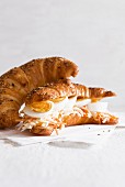 A croissant filled with hard-boiled eggs and coleslaw