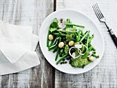 Green beans with a macadamia nut and herb pesto