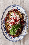 Oven-roasted aubergines with Greek yoghurt and pomegranate seeds