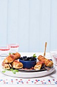 French toast rolls with cinnamon and Brie served with blueberry compote