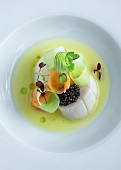 Scallop soup with caviar, leek and carrots