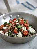 A lentil medley with peas, bacon and feta cheese
