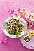 Bulgur salad with pomegranate seeds, herbs and broccoli (Arabia)