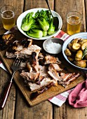 Roast pork belly with rosemary potatoes, bok choy and beer