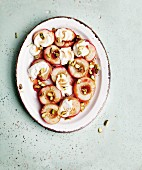 Roasted nectarine slices with vanilla yoghurt and pistachio nuts (seen from above)