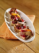 Canapés with chicken liver, apples and lingonberry compote