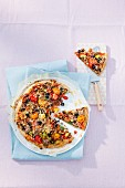 Homemade tuna fish pizza with cherry tomatoes and olives (seen from above)