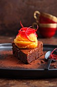 Blood orange and saffron sorbet on a slice of chocolate tart