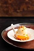 Poached peach halves with tonka bean ice cream