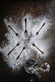 An arrangement of icing sugar and forks