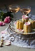 Pistachio rose cakes decorated with flower petals