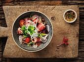 Thai salad with fried tuna, tomatoes and broccoli