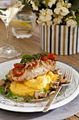 Mediterranean chicken breast fillet with cherry tomatoes on lemon polenta with mushrooms