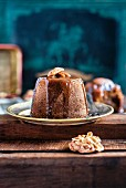 Sticky toffee pudding with dates, ginger and a brandy and toffee sauce