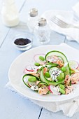 Hot-smoked salmon with an edamme and cucumber salad and radishes
