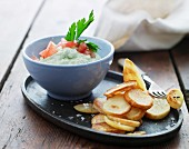 A creamy vegetable dip with fried potatoes