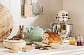Tea loaf, jams and hare figurine on Easter buffet table