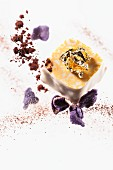A praline with gold leaf and candied violets