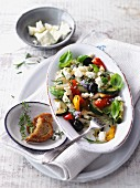 Vegetable antipasti with feta cheese and herbs