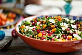 Herb salad with pomegranate seeds and flaked almonds
