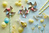 Still-life arrangement of windmills & sweeties in various pastel shades