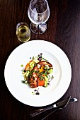Grilled octopus with vegetables and white wine