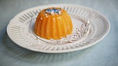 Pumpkin pudding with blue sugar sprinkles and a tiara