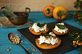 Persimmon with ricotta, walnuts and sage