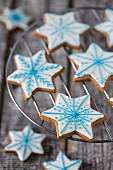 Gingerbread star biscuits decorated with blue and white icing