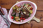 Rack of lamb with fried potatoes, beans and cherry tomatoes