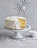 Coconut and mango cake with meringue