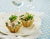 Pastries filled with prawns and peas