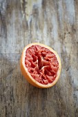 A halved, squeezed blood orange