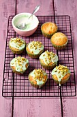 Pistachio cupcakes with green icing and chopped pistachios